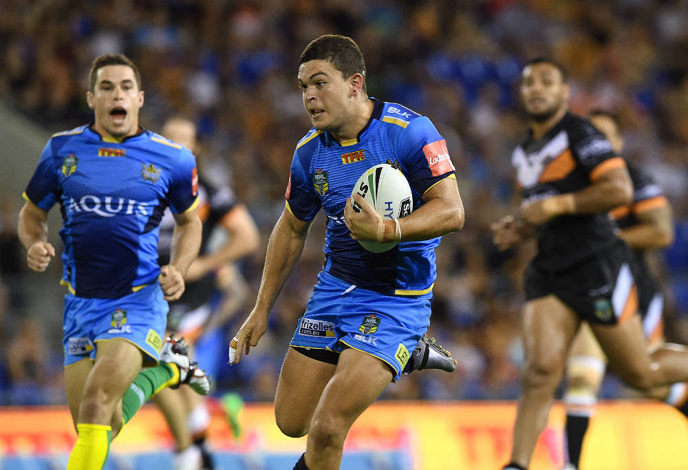 Titans rugby league player Ashley Taylor running with ball