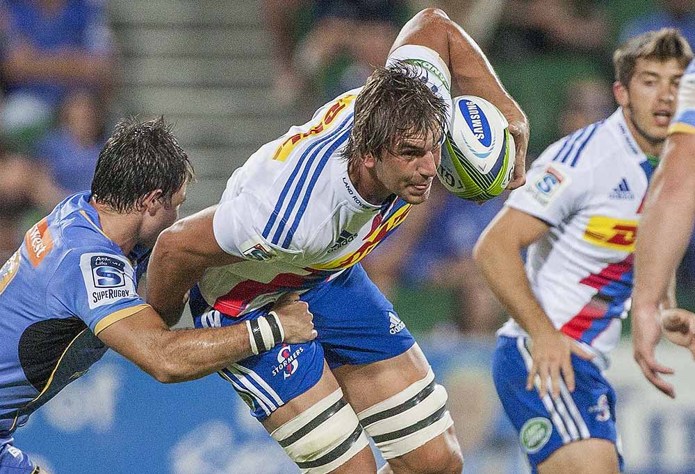 Eben Etzebeth makes a half break.