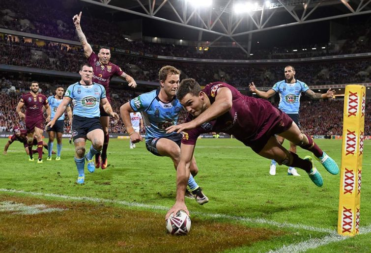 Maroons player Corey Oates crosses over to score