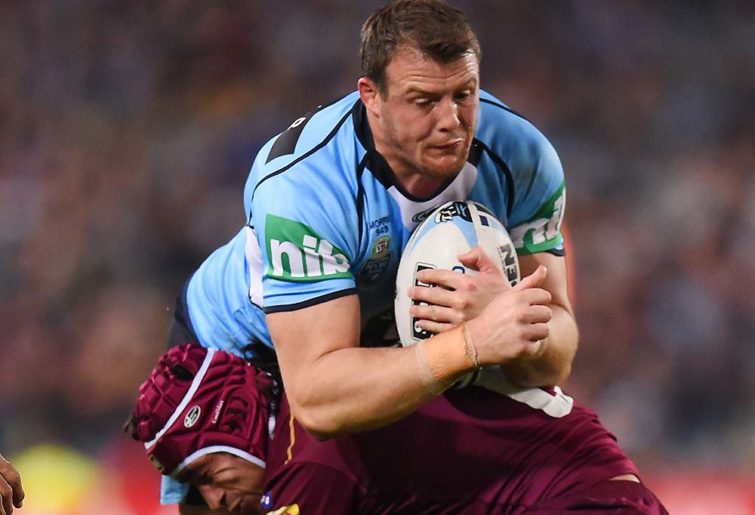 Josh Morris of the Blues is tackled by Johnathan Thurston of the Maroons