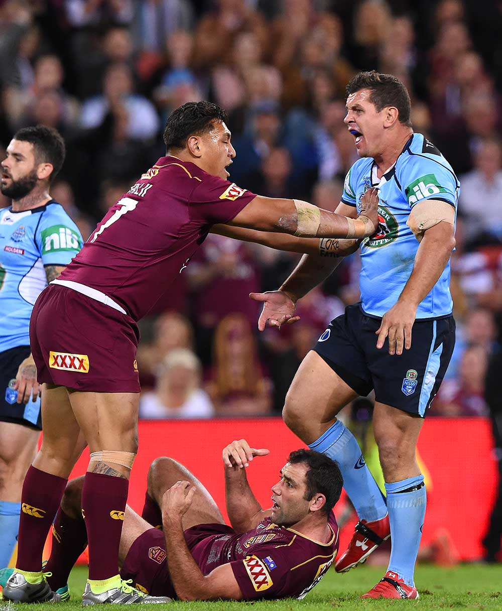 Maroons player Josh Papalii pushes Blues player Greg Bird