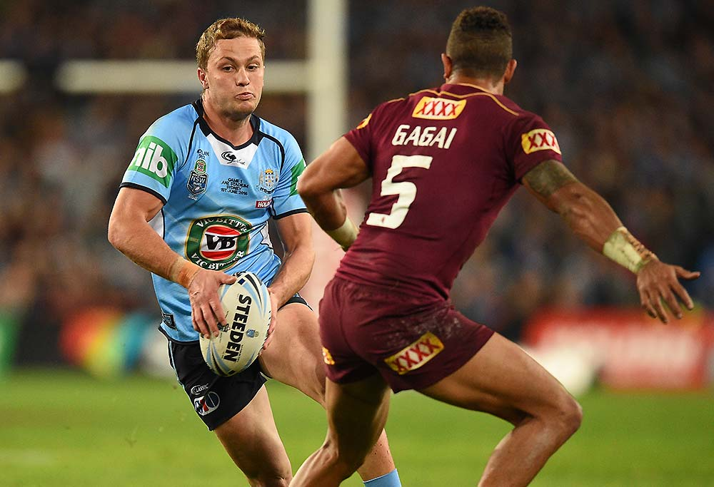 Matt Moylan of the Blues tries to avoid a tackle by Dane Gagai of the Maroons