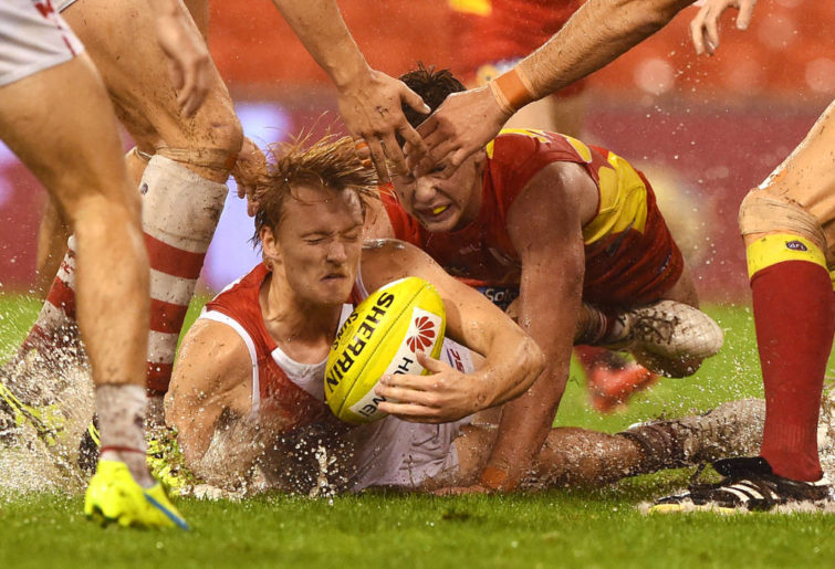 Sydney Swans player James Rose (centre) competes for the ball