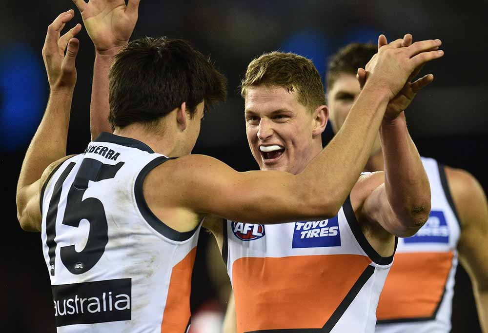 AFL players Matthew Kennedy and Jacob Hopper of the GWS Giants playing Essendon Bombers