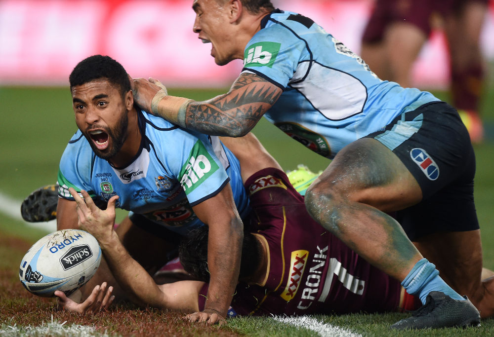 Michael Jennings of the Blues scores a try during the State of Origin