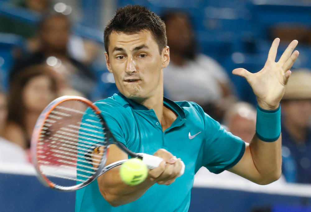 Bernard Tomic mid swing