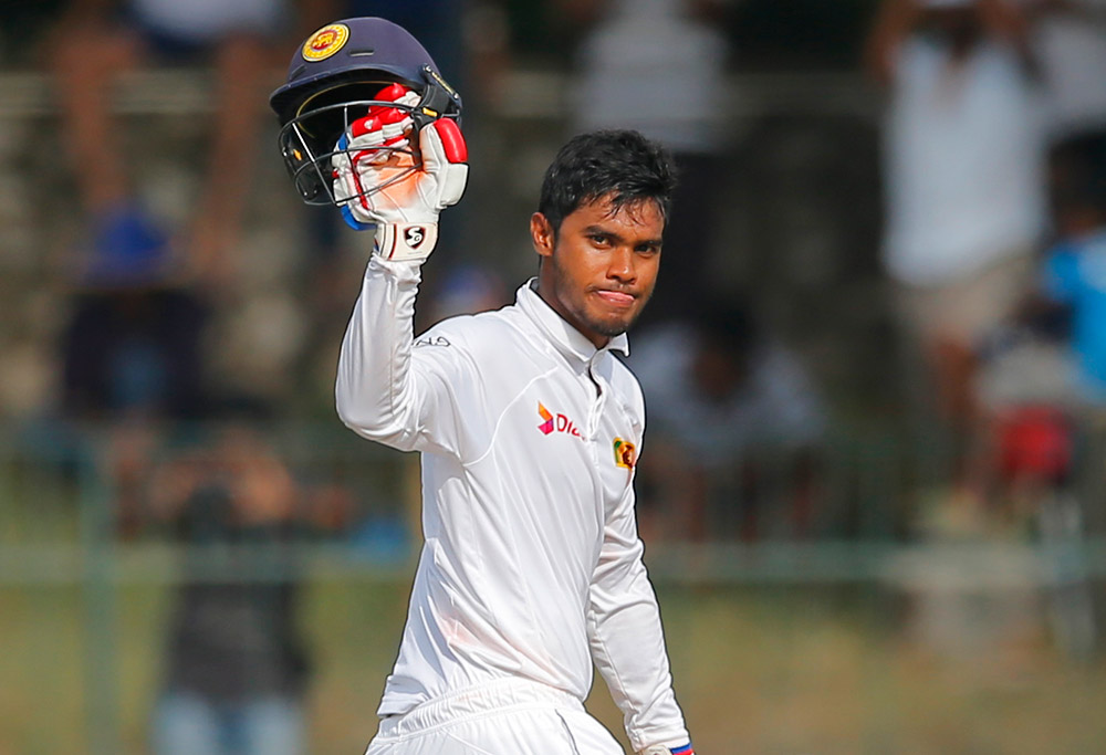 Sri Lanka's Dhananjaya de Silva celebrates scoring a hundred