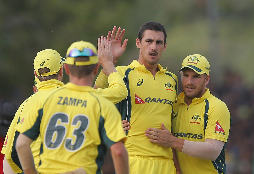 Mitchell Starc celebrates a wicket