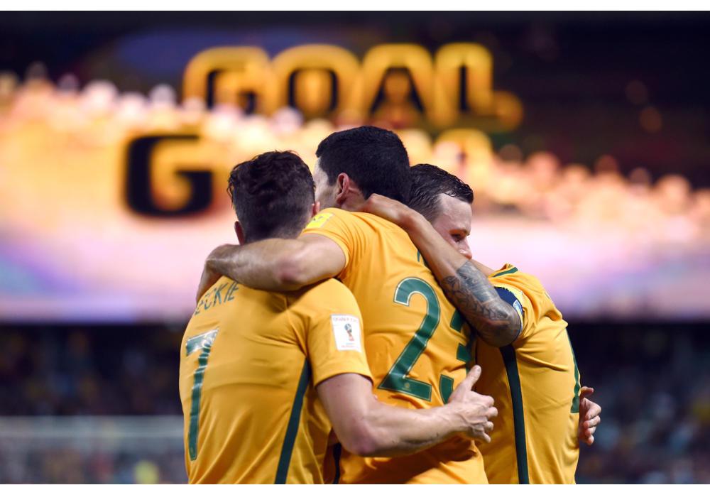Tomas Rogic congratulated by team generic football