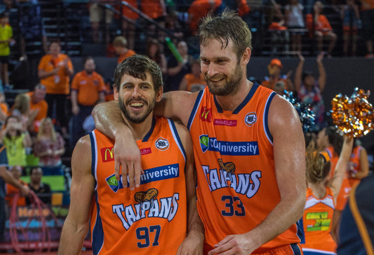 Cairns players Jarrad Weeks (left) and Mark Worthington react