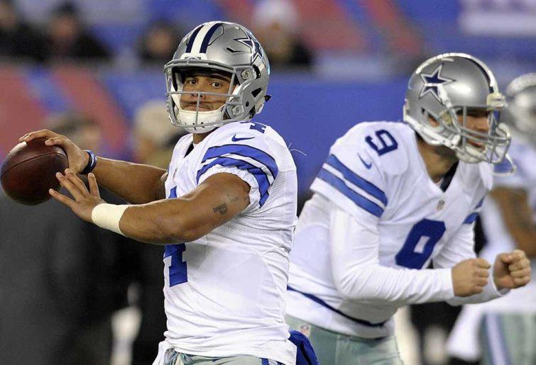 Dallas Cowboys quarterback Dak Prescott (4) and Tony Romo (9) warm up