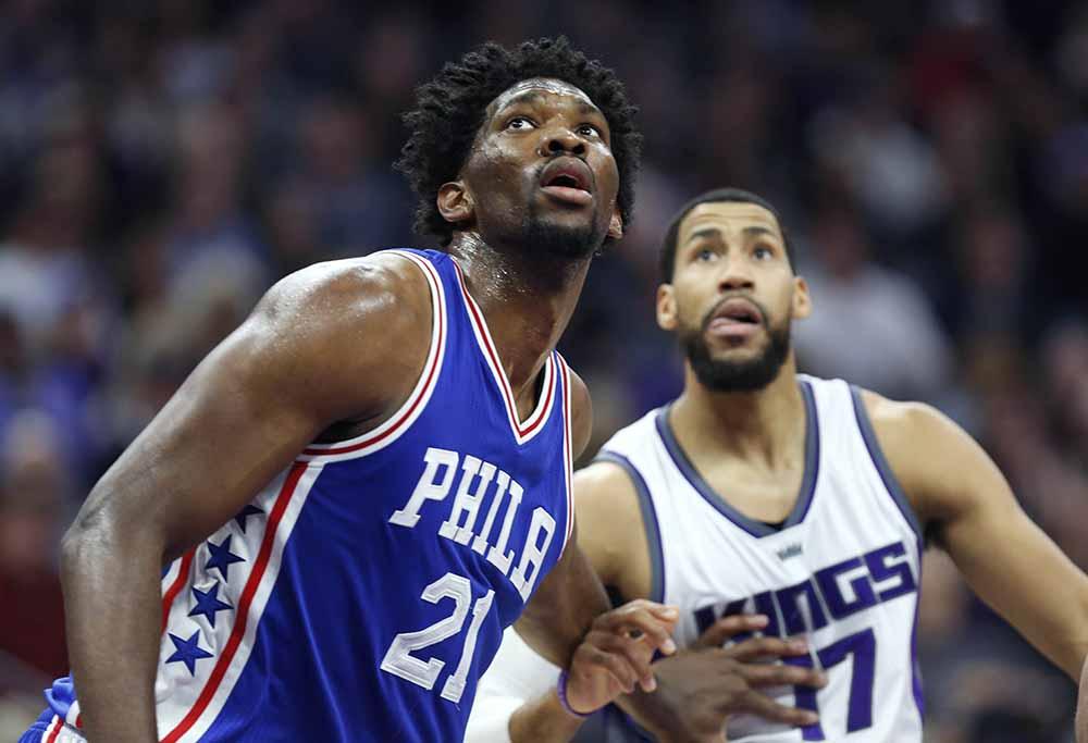 Philadelphia 76ers center Joel Embiid (21) and Sacramento Kings forward Garrett Temple