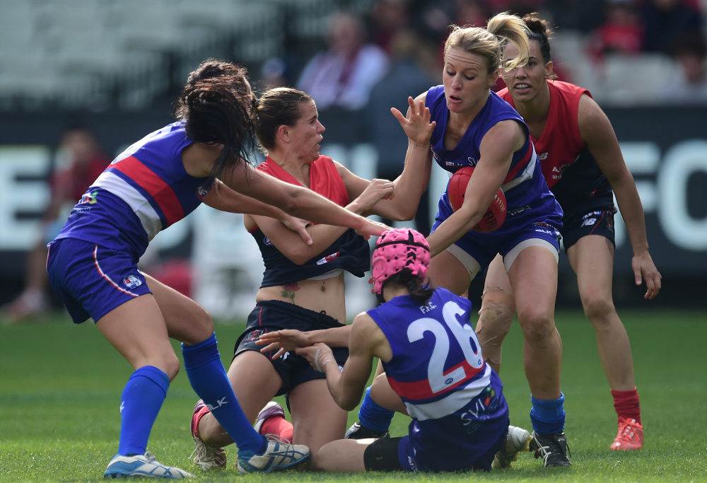Demons player Chelsea Randall tackled at the MCG