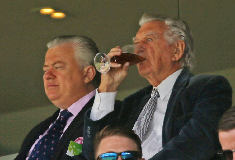Former Australian Prime Minster Bob Hawke, right, enjoys a drink