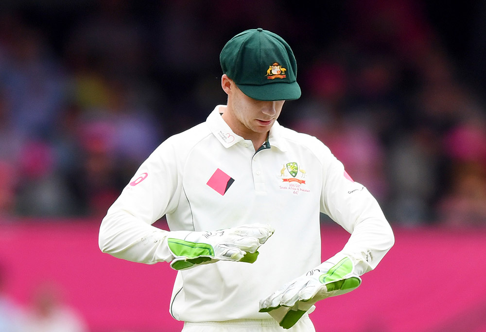 Peter Handscomb of Australia looks at the wicket keepers gloves