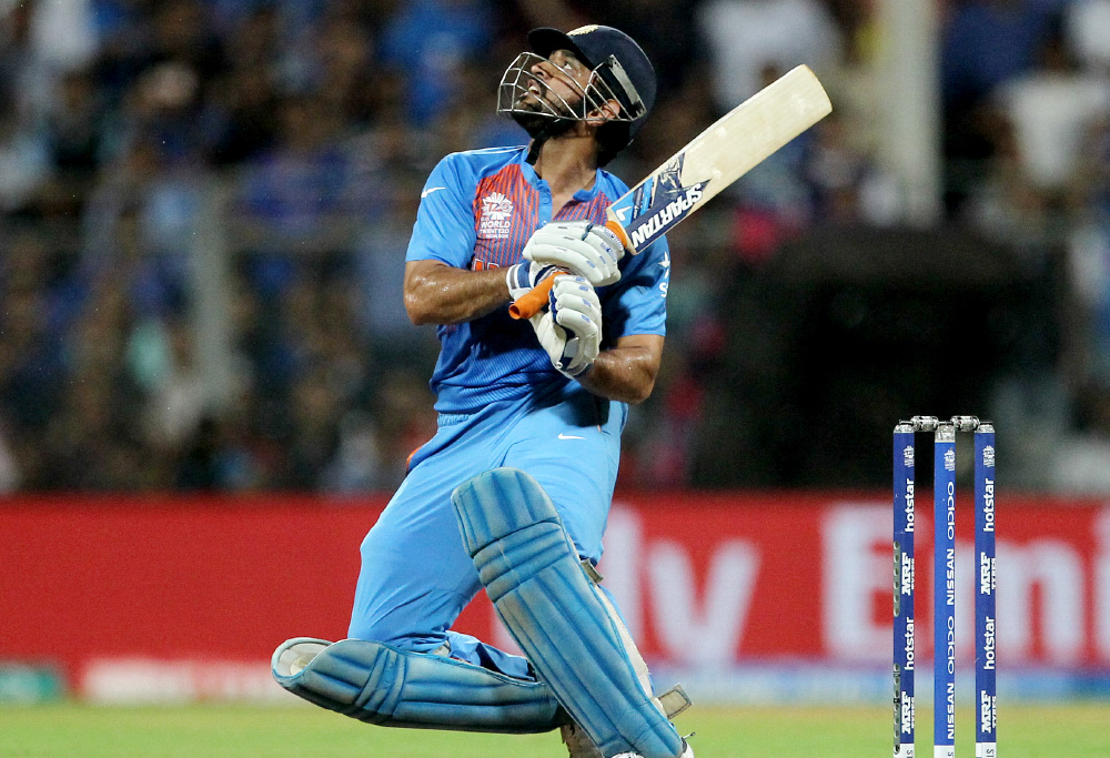 India's MS Dhoni bats during their ICC World Twenty20 2016 cricket semifinal match against the West Indies at Wankhede stadium in Mumbai, India,Thursday, March 31, 2016.