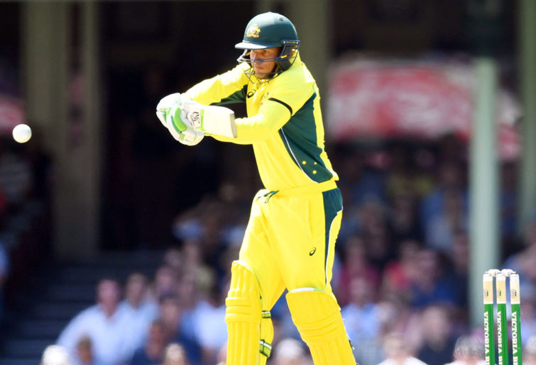 Usman Khawaja of Australia hits a shot