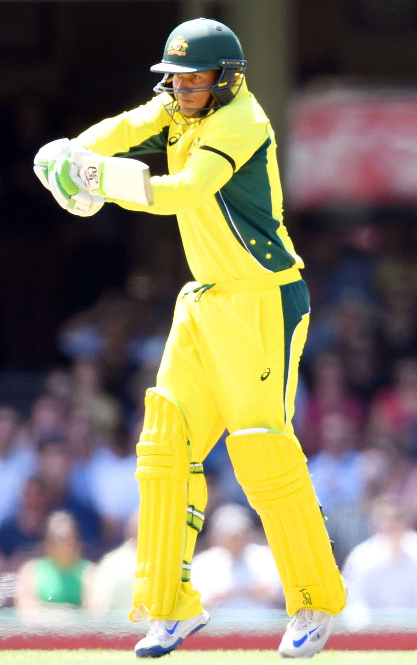 Usman Khawaja of Australia hits a shot