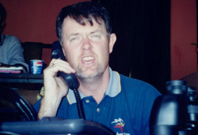 Glenn Mitchell calling the action on the phone, Eden Gardens, Kolkata 2001