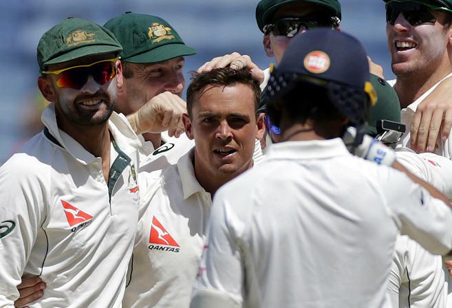 Australia's Steve O'Keefe celebrates the dismissal of India's Ajinkya Rahane