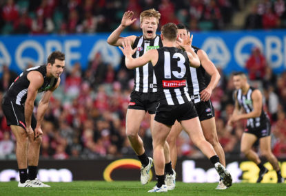 Pies hold off Lions for two in a row