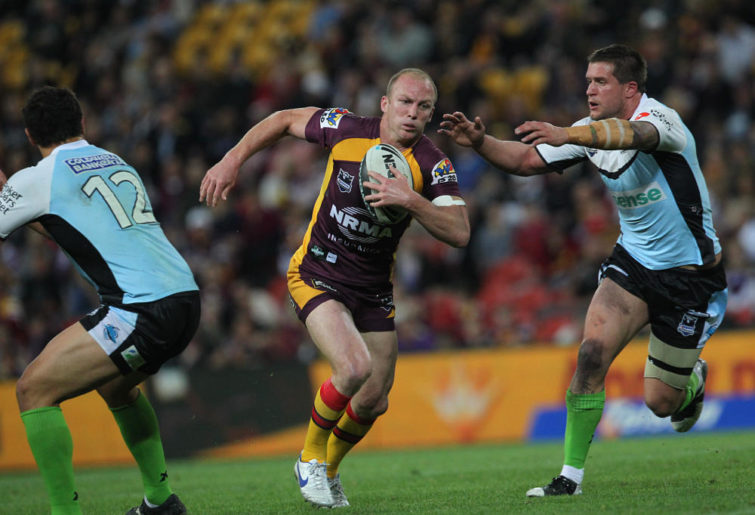 Darren Lockyer scythes through the defence