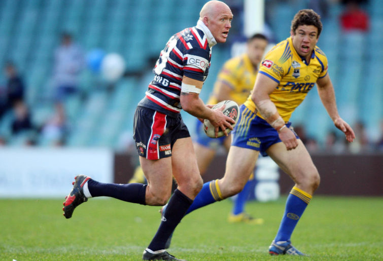 Craig Fitzgibbon runs with the ball