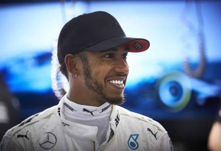 Lewis Hamilton smiles