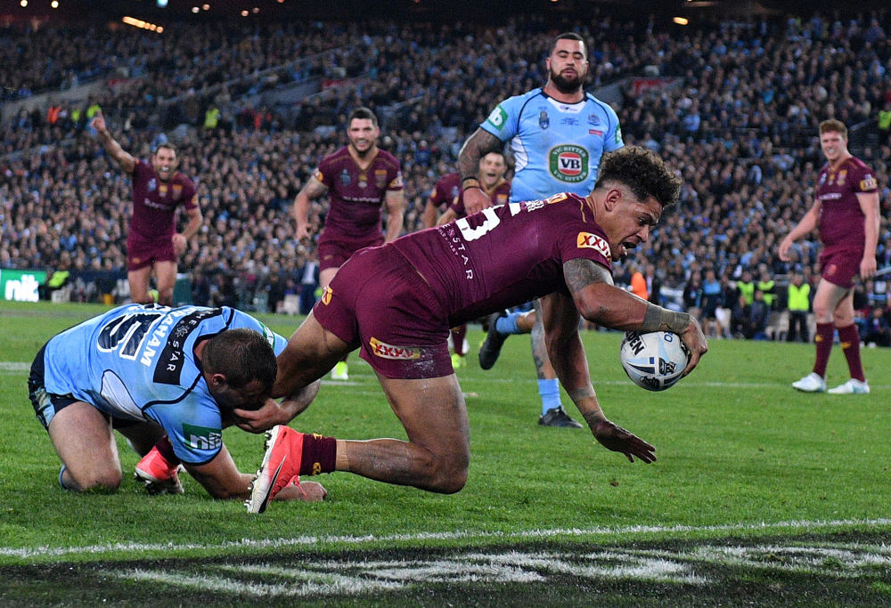 Dane Gagai scoring a try