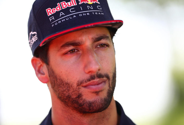 Formula One driver Daniel Ricciardo, of Red Bull, is interviewed by the media.