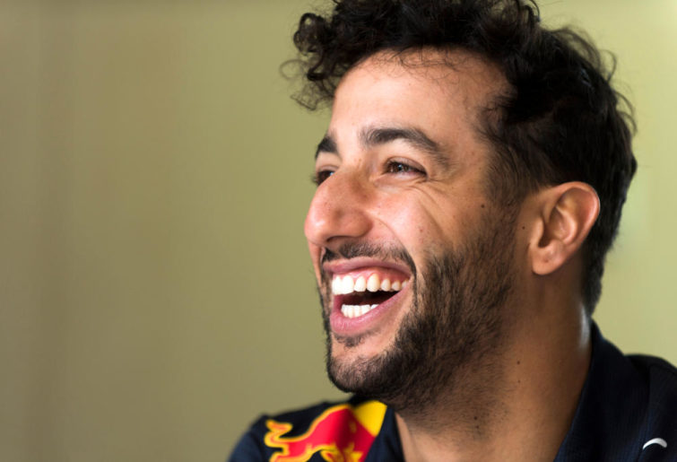 Daniel Ricciardo of Red Bull laughs during an interview with Formula One reporters.