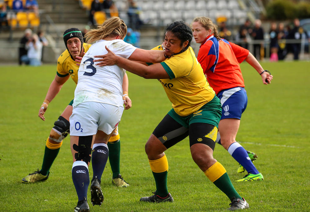 Evelyn Horomia makes a strong tackle against England