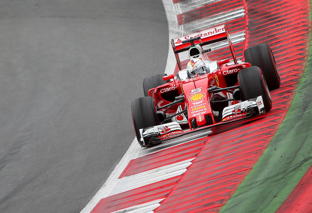 Sebastian Vettel rounds a corner at the Austrian Grand Prix in his Ferrari.