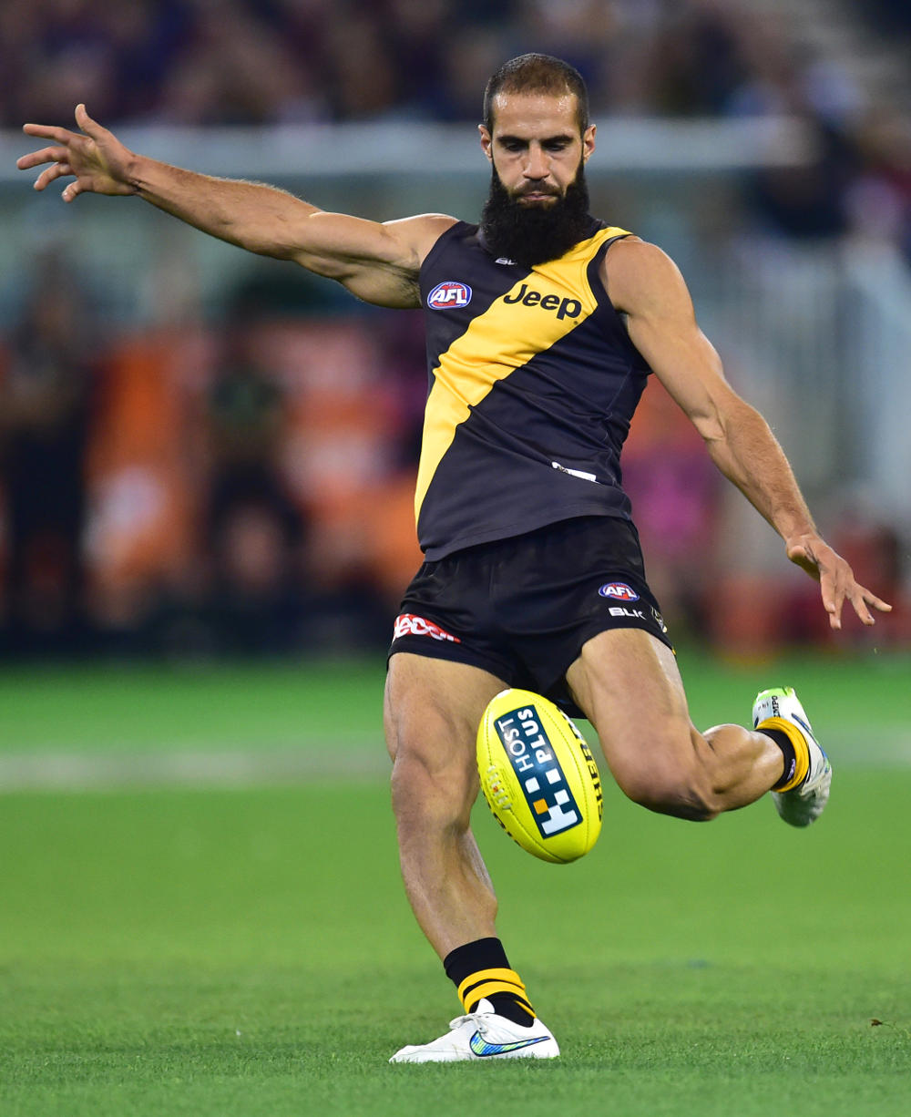 Bachar Houli shoots for goal for the Richmond Tigers