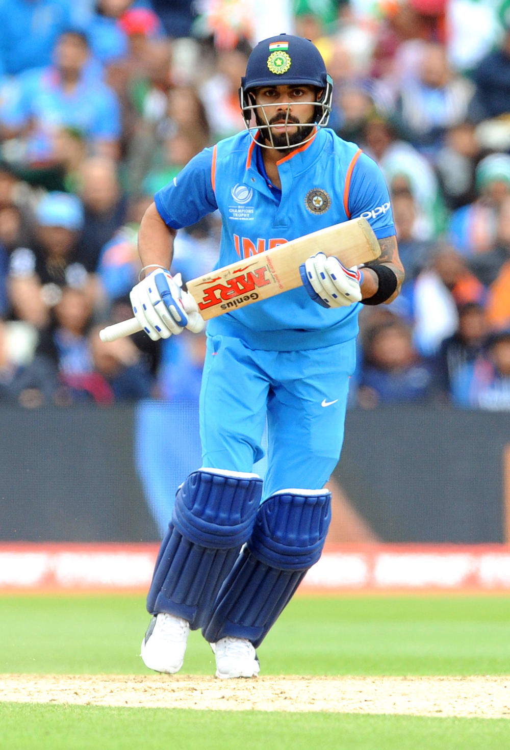 Virat Kohli runs after hitting a drive