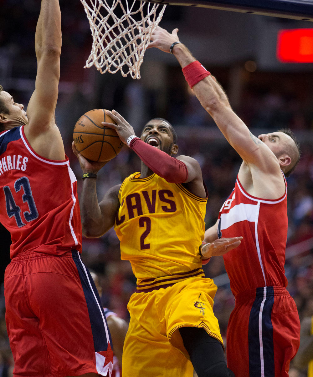 Kyrie Irving forces a layup for the Cavs