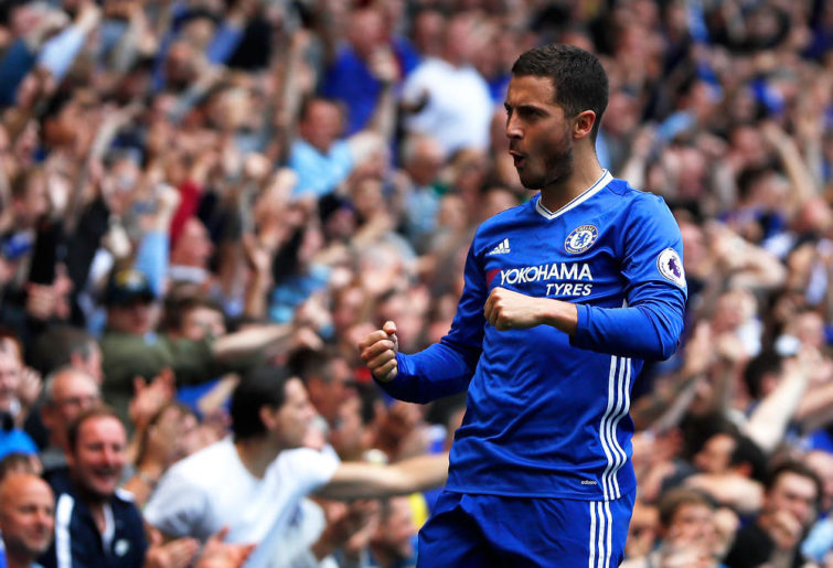 In this Sunday, May 21, 2017 file photo, Chelsea's Eden Hazard celebrates after scoring his side's second goal during their English Premier League soccer match against Sunderland at Stamford Bridge stadium in London. Eden Hazard will be joined at Premier League champion Chelsea by his younger brother, Kylian. The London club says the 22-year-old Kylian Hazard signed Tuesday, Aug. 29 for the development squad.