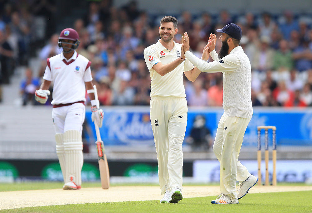 England's James Anderson (centre) celebrates with Moeen Ali after taking the wicket of West Indies Devendra Bishoo during day two of the the second Investec Test match at Headingley, Leeds. PRESS ASSOCIATION Photo. Picture date: Saturday August 26, 2017. See PA story CRICKET England. Photo credit should read: Nigel French/PA Wire.