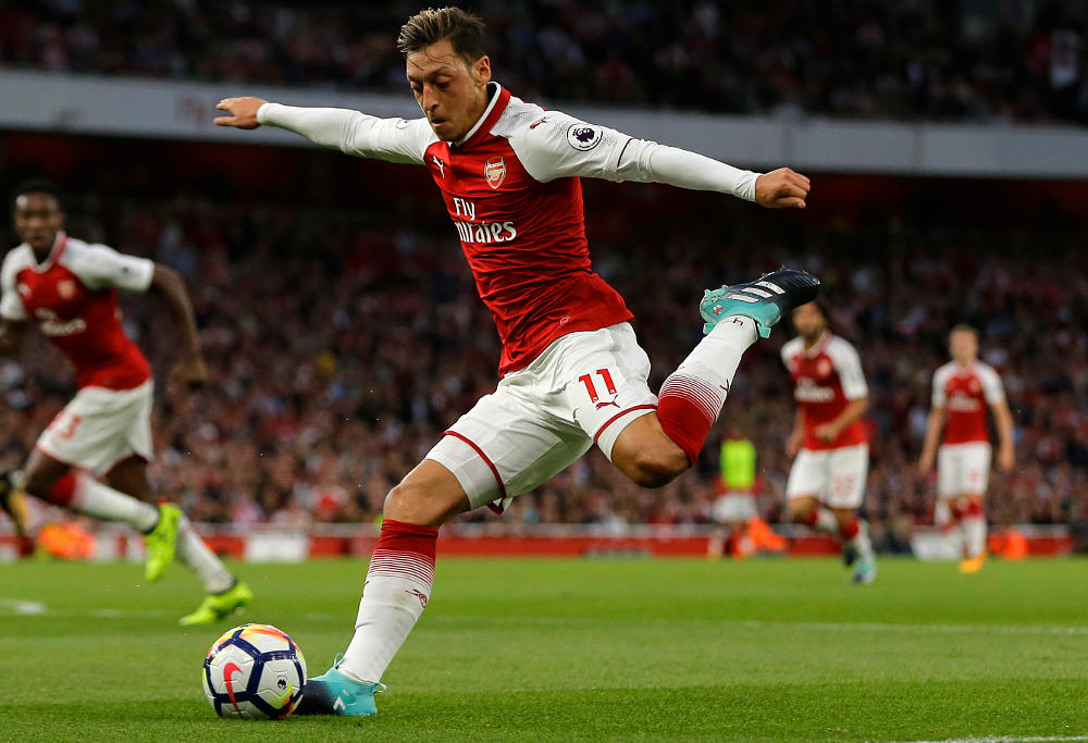 Arsenal's Mesut Ozil takes a shot on goal during their English Premier League soccer match between Arsenal and Leicester City at the Emirates stadium in London, Friday, Aug. 11, 2017.