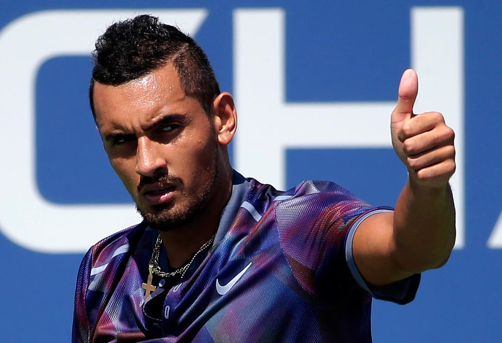 Nick Kyrgios, of Australia, reacts after scoring a point against John Millman, of Australia, during the first round of the U.S. Open tennis tournament, Wednesday, Aug. 30, 2017, in New York.
