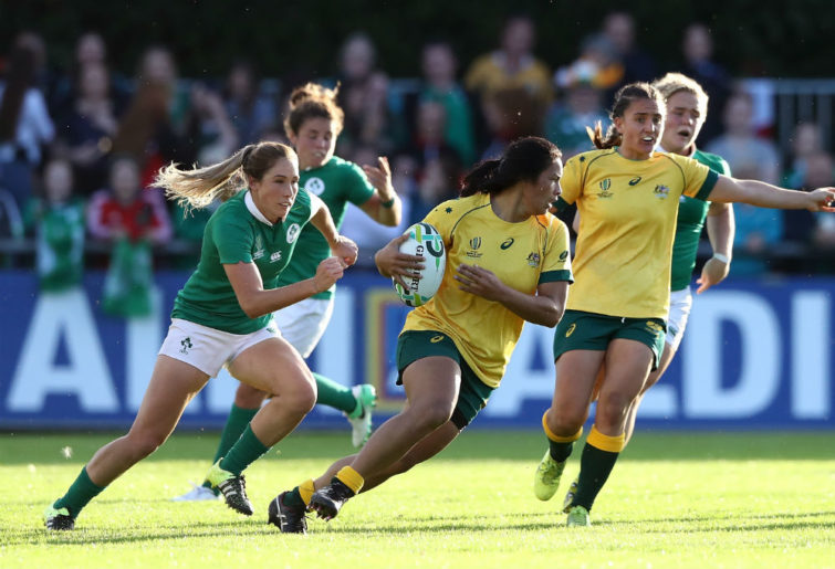 Liz Patu of Australia runs with the ball during the Women's Rugby World Cup