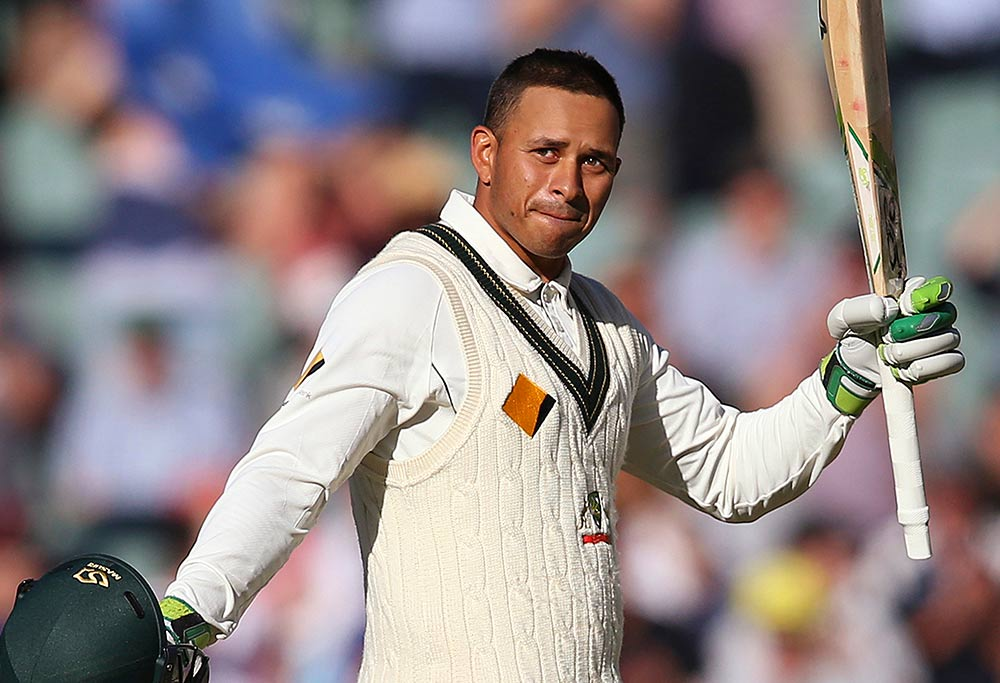 Australia's Usman Khawaja celebrates making 100 runs