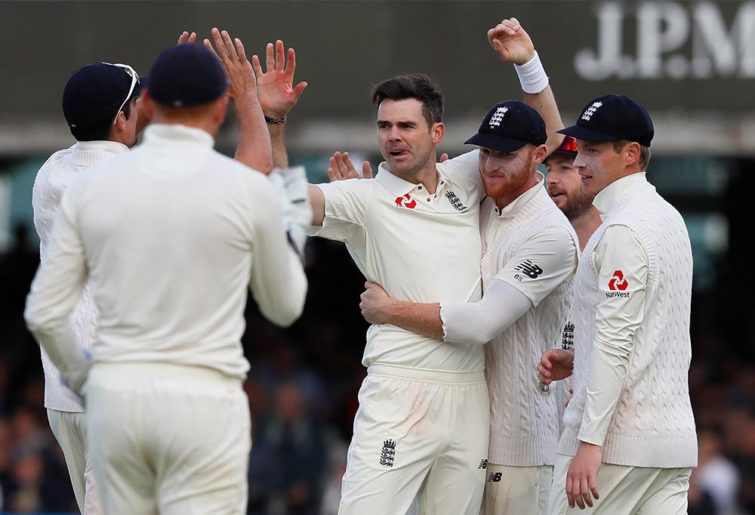 England's James Anderson, centre, celebrates taking a wicket