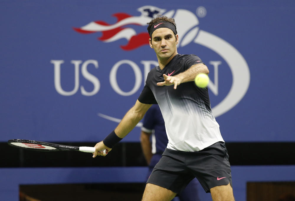 Roger Federer hits a ball at the US Open.