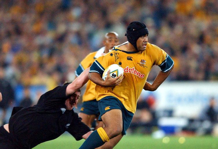 Toutai Kefu steps through the New Zealand All Blacks defence