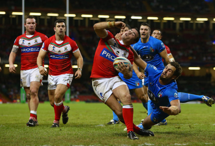 Matt Seamark of Wales is tackled by Joshua Mantellato (R) of Italy during the Rugby League World Cup Inter group match between Wales and Italy at the Millennium Stadium on October 26, 2013 in Cardiff, Wales.