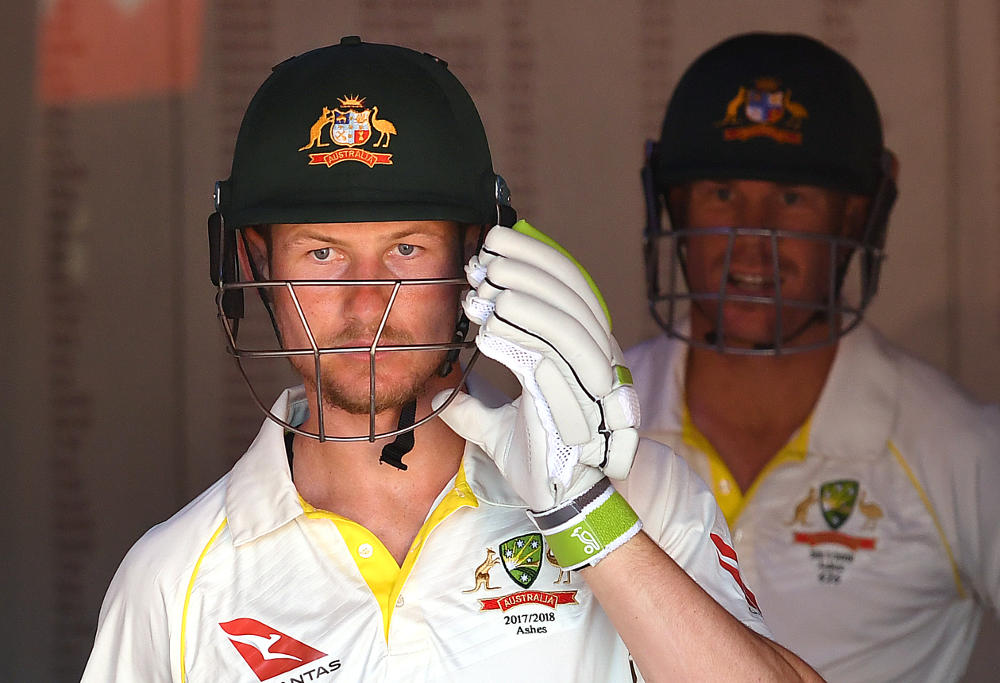 Australian opening batsman Cameron Bancroft walks out of the dressing rooms to bat in Australia's second innings on Day 4 of the First Test match between Australia and England at the Gabba in Brisbane, Sunday, November 26, 2017.