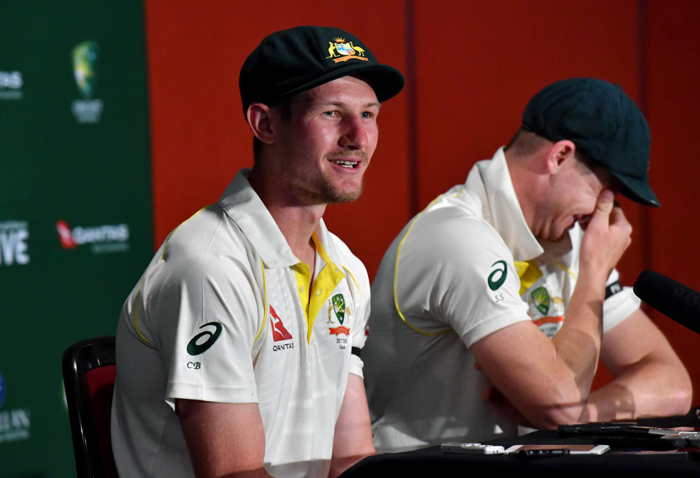 Cameron Bancroft (left) and Steve Smith (right) of Australia are seen reacting as they answer questions from the media about England wicketkeeper Jonny Bairstow at a post match press conference on Day 5 of the First Ashes Test match between Australia and England at the Gabba in Brisbane, Monday, November 27, 2017.