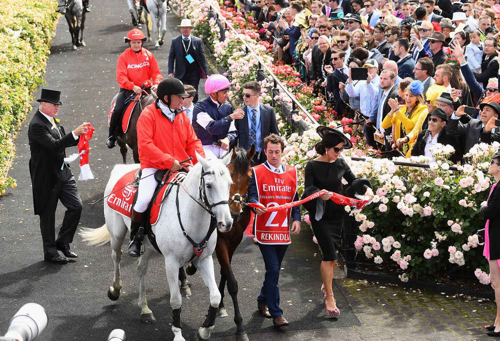 Corey Brown riding Rekindling celebrates as he returns to scale after winning race 7, the Emirates Melbourne Cup, during Melbourne Cup Day at Flemington Racecourse on November 7, 2017 in Melbourne, Australia. (Photo by Quinn Rooney/Getty Images)
