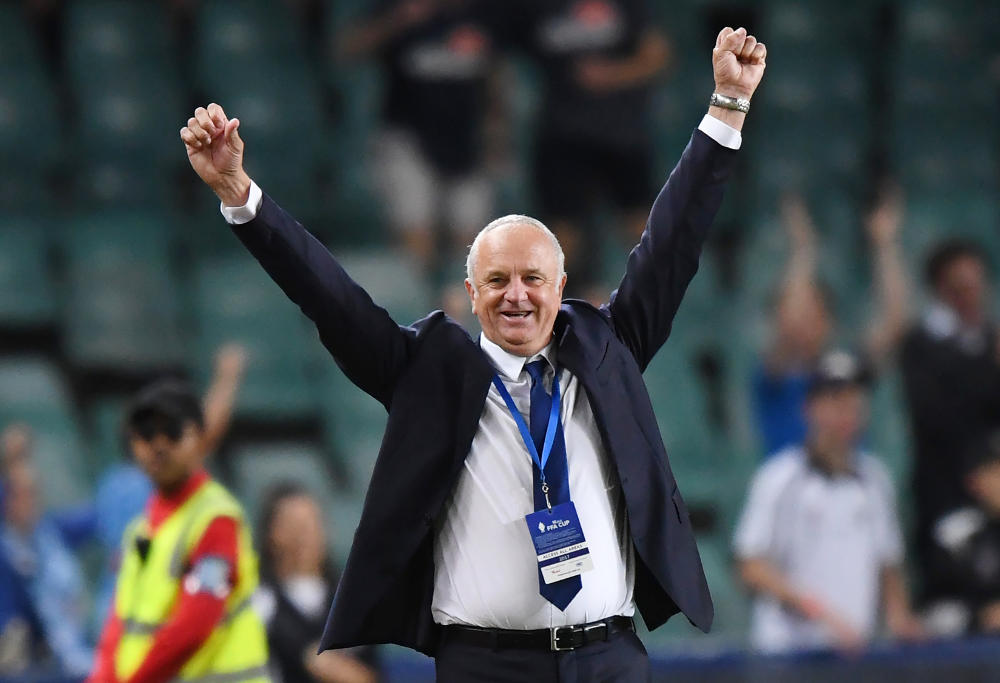 Sydney head coach Graham Arnold raises his arms as he celebrates victory at the final whistle during the FFA Cup Final between Sydney FC and Adelaide United at Allianz Stadium in Sydney, Saturday, November 121, 2017.